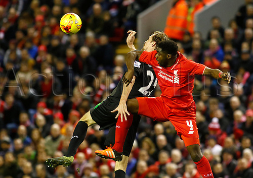 26.01.2016. Anfield, Liverpool, England. Capital One Cup Semi Final 2nd Leg. Liverpool versus Stoke. Liverpool defender Kolo Touré wins an aerial ball against Stoke striker Peter Crouch.