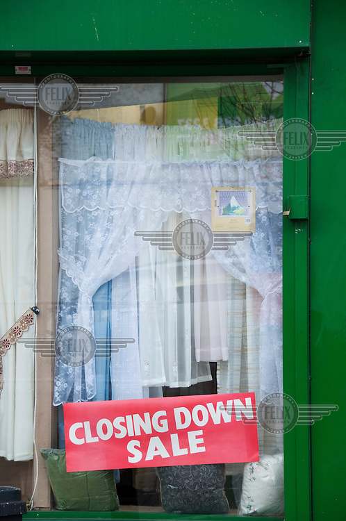A curtain shop closing down in Hackney, London, a victim of the global credit crunch.