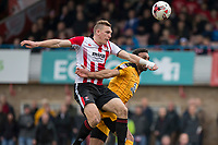 Danny Wright of Cheltenham Town battles with Leon Legge of Cambridge United during the Sky Bet League 2 match between Cheltenham Town and Cambridge United at the LCI Stadium, Cheltenham, England on 18 March 2017. Photo by Mark  Hawkins / PRiME Media Images.