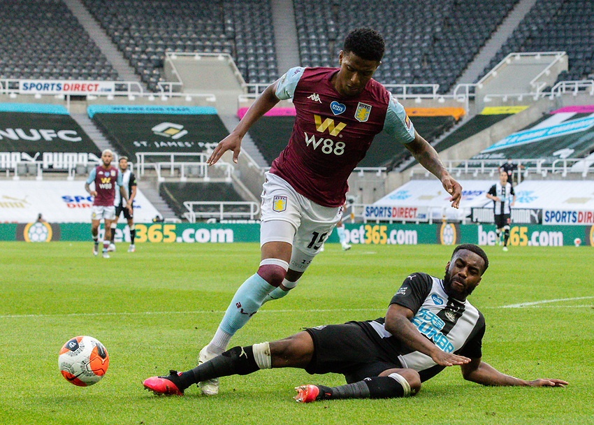 Aston Villa's Ezri Konsa is tackled by Newcastle United's Danny Rose<br /> <br /> Photographer Alex Dodd/CameraSport<br /> <br /> The Premier League - Newcastle United v Aston Villa - Wednesday 24th June 2020 - St James' Park - Newcastle <br /> <br /> World Copyright © 2020 CameraSport. All rights reserved. 43 Linden Ave. Countesthorpe. Leicester. England. LE8 5PG - Tel: +44 (0) 116 277 4147 - admin@camerasport.com - www.camerasport.com