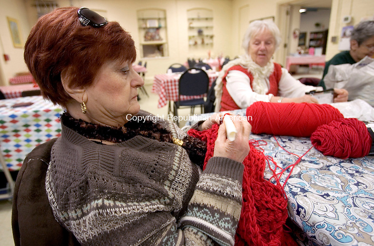 NAUGATUCK CT. 27 January 2014-012714SV06-Maria Tabich of Naugatuck works on an afghan quilt during a craft and stitch session at the Senior Center in Naugatuck Monday. The seniors work all year on the handmade items for the Holiday Bazaar the first week of December.<br /> Steven Valenti Republican-American