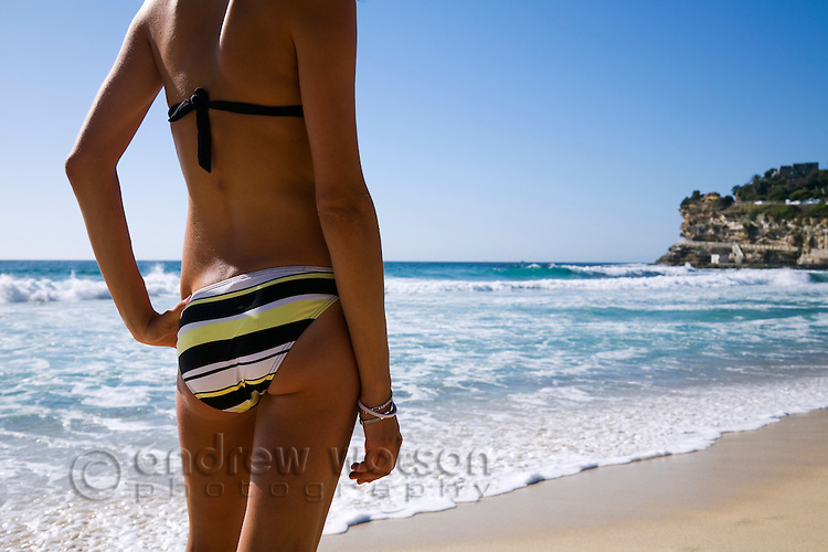 Young woman on the beach.  Bronte Beach, Sydney, New South Wales, AUSTRALIA.