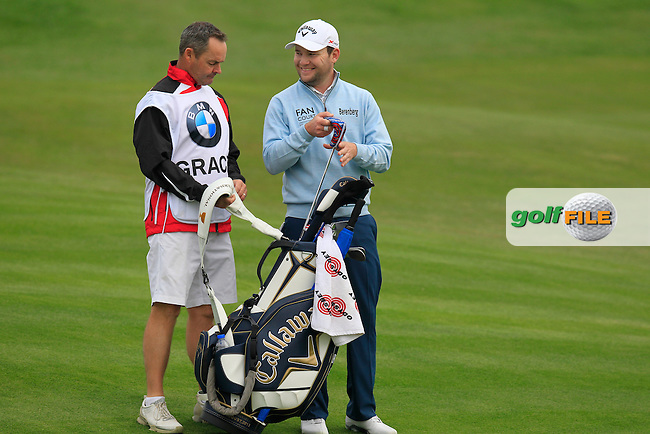 Branden Grace (RSA) and caddy Billy Foster at the 13th green during Friday's Round 2 of the 2013 BMW Masters presented by SRE Group held at Lake Malaren Golf Club, Shanghai, China. 25th October 2013.<br /> Picture: Eoin Clarke/www.golffile.ie