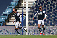 Mason Bennett of Millwall (L) scores the first goal for his team and celebrates during Millwall vs Swansea City, Sky Bet EFL Championship Football at The Den on 30th June 2020