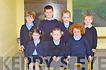 FIRST TIMERS: The new Junior Infants class on Clogher NS, Ballymacelligott enjoying their first day of school on Monday seated l-r: Maggie Scanlon, Alice Brosnan and Emma Daly. Back l-r: Dave Lucid, Conor Lucid, Laura Kelly and Christopher Mannix.