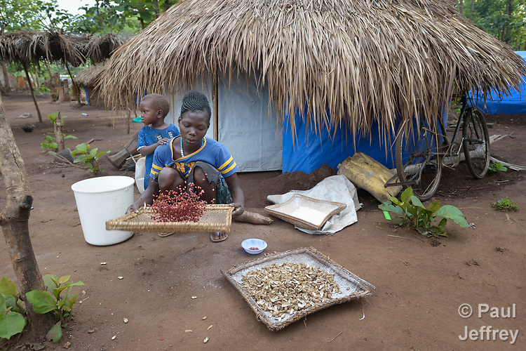 A woman threshes peanuts in a camp for more than 5,000 displaced people in Riimenze, in South Sudan's Gbudwe State, what was formerly Western Equatoria. Families here were displaced at the beginning of 2017, as fighting between government soldiers and rebels escalated.<br />