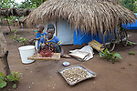 A woman threshes peanuts in a camp for more than 5,000 displaced people in Riimenze, in South Sudan's Gbudwe State, what was formerly Western Equatoria. Families here were displaced at the beginning of 2017, as fighting between government soldiers and rebels escalated.<br /> <br /> Two Catholic groups, Caritas Austria and Solidarity with South Sudan, have played key roles in assuring that the displaced families here have food, shelter and water.<br /> The camp formed around the Catholic Church in Riimenze as people fled violence in nearby villages for what they perceived as the safety offered by the church.