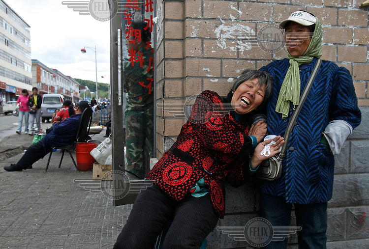 Elderly woman laugh on a street in Fuyan township on the bank of the Amur River. The Amur runs along the border separating Russia and China.