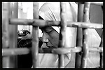 Wrapped in white Muslim traditional clothes Obeida Khalil a member of the Islamic Jihad movement is seen in her cell at Hasharon Israeli prison. ..Khalil, 29 was arrested by Israeli soldiers when she was preparing for a suicide attack in Tel Aviv bus station. Photo by Quique Kierszenbaum..