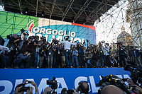 """Matteo Salvini (Leader of the Lega/League, former Deputy Prime Minister & Minister of the Interior of Italy) surrounded by lens journalists.<br /> <br /> Rome, 19/10/2019. Today, tens thousands of people (200,000 for the organisers, 50,000 for the police) gathered in Piazza San Giovanni to attend the national demonstration """"Orgoglio Italiano"""" (Italian Pride) of the far-right party Lega (League) of Matteo Salvini. The demonstration was supported by Silvio Berlusconi's party Forza Italia and Giorgia Meloni's party Fratelli d'Italia (Brothers of Italy, right-wing).  <br /> The aim of the rally was to protest against the Italian coalition Government (AKA Governo Conte II, Conte's Second Government, Governo Giallo-Rosso, 1.) lead by Professor Giuseppe Conte. The 66th Government of Italy is a coalition between Five Star Movement (M5S, 2.), Democratic Party (PD – Center Left, 3.), and Liberi e Uguali (LeU – Left, 4.), these last two parties replaced Lega / League as new members of a coalition based on Parliamentarian majority as stated in the Italian Constitution. The Governo Conte I (Conte's First Government, 5.) was 14-month-old when, between 8 and 9 of August 2019, collapsed after the Interior Minister Matteo Salvini withdrew his euroskeptic, anti-migrant, right-wing Lega / League (6.) from the populist coalition in a pindaric attempt (miserably failed) to trigger a snap election.<br /> <br /> Footnotes & Links:<br /> 1. http://bit.do/feK6N<br /> 2. http://bit.do/e7JLx<br /> 3. http://bit.do/e7JKy<br /> 4. http://bit.do/e7JMP<br /> 5. http://bit.do/e7JH7<br /> 6. http://bit.do/eE7Ey<br /> https://www.leganord.org<br /> http://bit.do/feK9X (Source, TheGuardian.com)<br /> Reportage: """"La Fabbrica Della Paura"""" (The Factory of Fear): http://bit.do/feLcy (Source Report, Rai.it - ITA)<br /> (Update) Reportage: """"La Fabbrica Social Della Paura"""" (The Social Network Factory of Fear): http://bit.do/fe8Pn (Source Report, Rai.it - ITA)"""