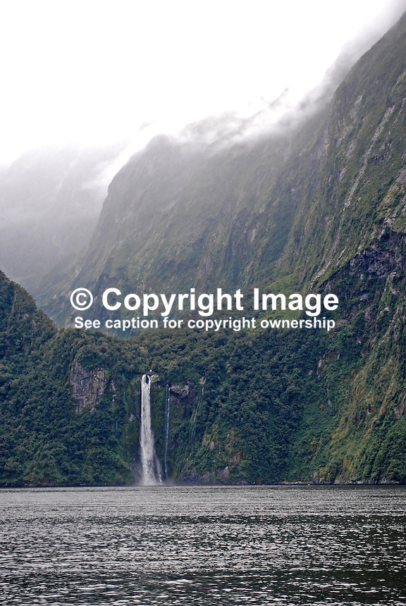 Milford Sound is New Zealand's top tourist destination. It was described by Rudyard Kipling as the Eighth Wonder of the World. Geographically it is not a sound but a fijord. It is 15 kilometres long and its sheer rock interfaces rise to 1200 metres. 201004055032..© Victor Patterson, 54 Dorchester Park, Belfast, N Ireland. Tel: +44 2890661296; Mobile: +44 7802 353836; Emails: victorpatterson@me.com & victorpatterson@gmail.com; www.victorpatterson.com