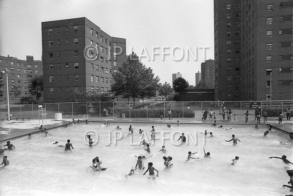 August 1971, Harlem, New York City, New York State, USA --- People cool off in the local neighborhood swimming pool, near the North of Central Park. --- Image by © JP Laffont