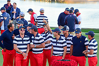 Team U.S.A. has some fun as they gather for a team photo following the 2017 President's Cup, Liberty National Golf Club, Jersey City, New Jersey, USA. 10/1/2017. <br /> Picture: Golffile | Ken Murray<br /> <br /> All photo usage must carry mandatory copyright credit (&copy; Golffile | Ken Murray)