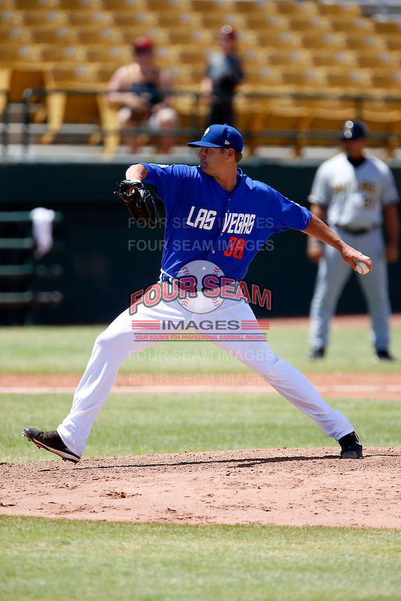 Sean Henn #38 of the Las Vegas 51s pitches against the Salt Lake Bees at Cashman Field on May 27, 2013 in Las Vegas, Nevada. Las Vegas defeated Salt Lake, 9-7. (Larry Goren/Four Seam Images)
