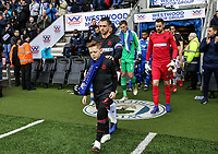 Bolton Wanderers' Andrew Taylor leads his team out at the DW Stadium with Bolton Wanderers' mascot<br /> <br /> Photographer Andrew Kearns/CameraSport<br /> <br /> The EFL Sky Bet Championship - Wigan Athletic v Bolton Wanderers - Saturday 16th March 2019 - DW Stadium - Wigan<br /> <br /> World Copyright &copy; 2019 CameraSport. All rights reserved. 43 Linden Ave. Countesthorpe. Leicester. England. LE8 5PG - Tel: +44 (0) 116 277 4147 - admin@camerasport.com - www.camerasport.com
