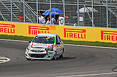 A Nissan Micra with front end dammage after an accident  keeps on racing during the Grand Prix of Canada  at Circuit Gilles-Villeneuve