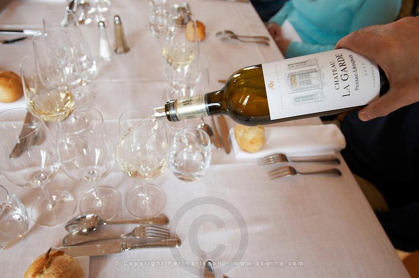 Lunch with white wine chateau la garde pessac leognan graves bordeaux france