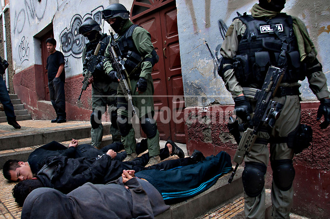 A special police squad flight suspected of criminal acts in a suburb of La Paz, Bolivia