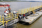 {8/24/12} {10pmCST} Greenville , MS, U.S.A. --Workers on The Dredge JADWIN, of the US Army Corp of Engineers, begin dredging a stretch of the Mississippi River 7 miles downriver from Greenville MS. where the Army Corp of Engeineers is dredging the river to keep it open to tug boat traffic. Pictured workers connect the JADWIN to a 1000 foot pipeline to carry out the sludge.  Sandbars creep up as the water level drops on the Mississippi River makeing navigating the Mississippi River difficult for tug boat captains Ron Mook , Friday August 24,2012. Historically low river levels on the Mississippi River are causing havoc on river traffic: grounding barges loaded with grain and fertilizer, traffic jams several miles long and forcing the Coast Guard to close down chunks of the river due to groundings. The area around Greenville, Miss., has closed three times the past week due to groundings. Last year, there were five total groundings the entire low-water season. Locals who fought historic high-water floods last year are this year engaged in a different fight: keeping barges afloat on a vanishing Mississippi.  -- Photo by Suzi Altman, .