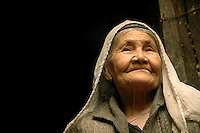 A Uyghur woman in the courtyard of her home in the Old City of Kashgar. The Uyghurs of China's remote Xinjiang Uyghur Autonomous Region are a mainly Sunni Muslim minority group. By the 15th century, Islam had become the dominant religion throughout the entire Taklamakan region..