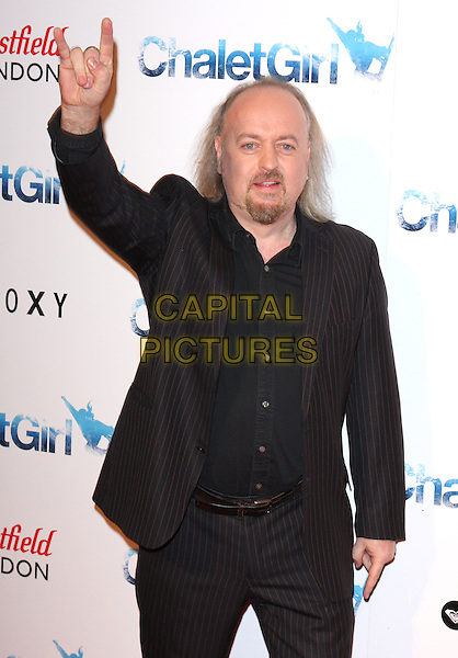 BILL BAILEY .World Premiere of 'Chalet Girl' at Vue cinema, Westfield Shopping Cnetre, London, England, UK, .February 8th 2011..half length hand arm raised up black suit shirt gesture goatee facial hair beard .CAP/ROS.©Steve Ross/Capital Pictures