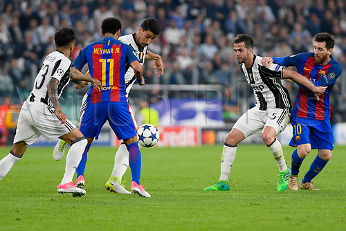 April 11th 2017, Juventus Stadium, Turin, Italy; UEFA Champions league football quarterfinal, leg 1, Juventus versus Barcelona; Juventus defenders conver Lionel Messi and Neymar
