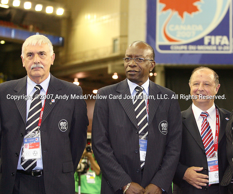 30 June 2007: Canadian Soccer Association President Colin Linford (l), CONCACAF President and FIFA Vice-President Jack Warner, and Francis Millien (r), head of the Montreal Local Organizing Committee. At Le Stade Olympique in Montreal, Quebec, Canada. Poland's Under-20 Men's National Team defeated Brazil's Under-20 Men's National Team 1-0 in a Group D opening round match during the FIFA U-20 World Cup Canada 2007 tournament.