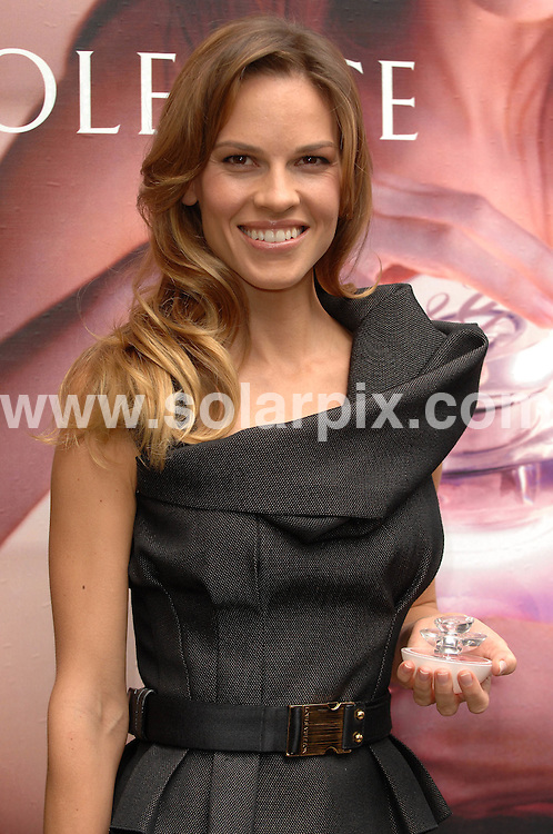 **ALL ROUND PICTURES FROM SOLARPIX.COM**.**WORLDWIDE SYNDICATION RIGHTS**.Hilary Swank attends a photocall in London for the launch of the new Guerlain 'Insolence' perfume range at Selfridges, Oxford Street, London. 27th September 2007...This pic: Hilary Swank..JOB REF: 4856 SSD     DATE: 27_09_2007.**MUST CREDIT SOLARPIX.COM OR DOUBLE FEE WILL BE CHARGED* *UNDER NO CIRCUMSTANCES IS THIS IMAGE TO BE REPRODUCED FOR ANY ONLINE EDITION WITHOUT PRIOR PERMISSION*