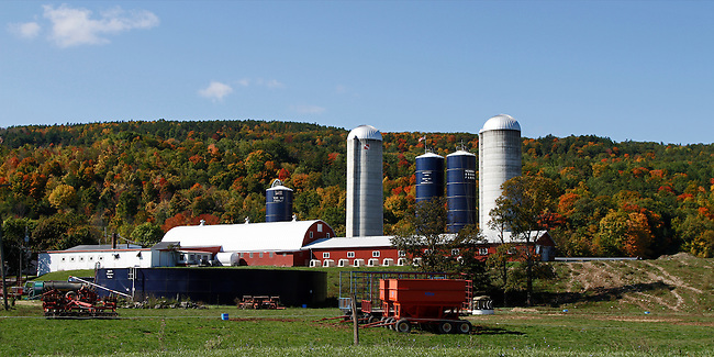 A beautiful panorama of the Van Wie Family farm in Bethlehem, New York. The farm with its barns, silos and farm equipment backed by a mountain redundant in fall colors exemplifies the farming communities throughout the state.