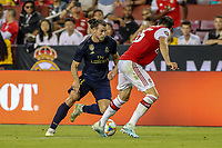 Landover, MD - July 23, 2019:  Real Madrid Gareth Bale (11) runs by an Arsenal defender during the match between Arsenal and Real Madrid at FedEx Field in Landover, MD.   (Photo by Elliott Brown/Media Images International)