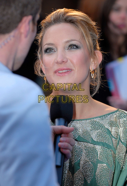 """KATE HUDSON .""""Fool's Gold"""" - UK film premiere,.Vue Leicester Square, London, .April 10th 2008..Fools portrait headshot green microphone being interviewed .CAP/IA.©Ian Allis/Capital Pictures"""