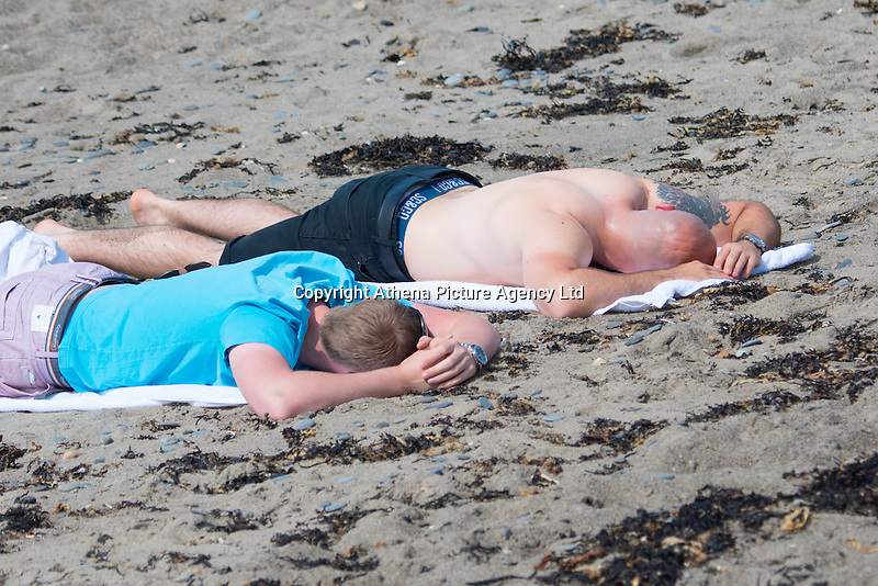 Aberystwyth Wales UK, Thursday 12 May 2016<br /> UK Weather: People sunbathing on the beach at the seaside in  Aberystwyth, on the Cardigan Bay coast of west Wales, enjoying a last day of warm weather in the current mini-heatwave. <br /> The temperatures are set to fall over the coming days, with bright but colder conditions prevailing over the country