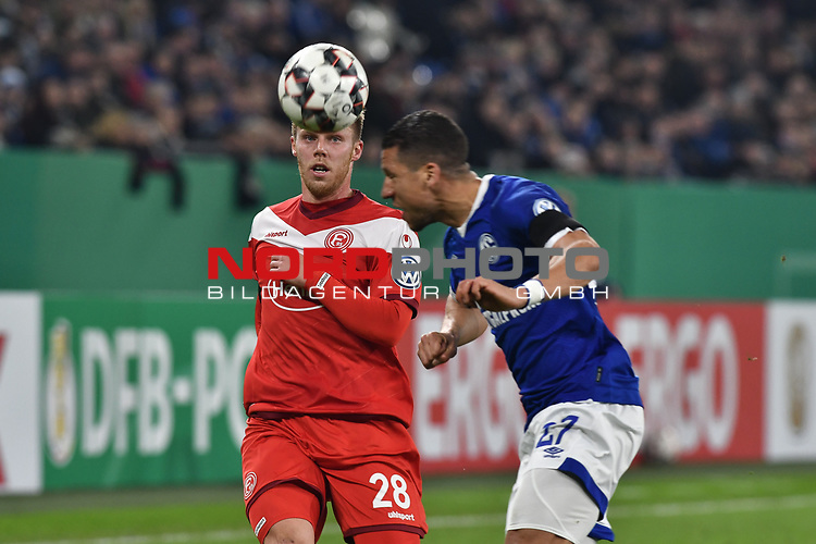06.02.2019, Veltins-Arena, Gelsenkirchen, GER, DFB-Pokal Achtelfinale, Schalke 04 vs Fortuna Duesseldorf, DFL regulations prohibit any use of photographs as image sequences and/or quasi-video<br /> <br /> im Bild v. li. im Zweikampf Rouwen Hennings (#28, Fortuna Düsseldorf / Duesseldorf) Jeffrey Bruma-van Homoet (#27 FC Schalke 04)<br /> <br /> Foto © nph/Mauelshagen
