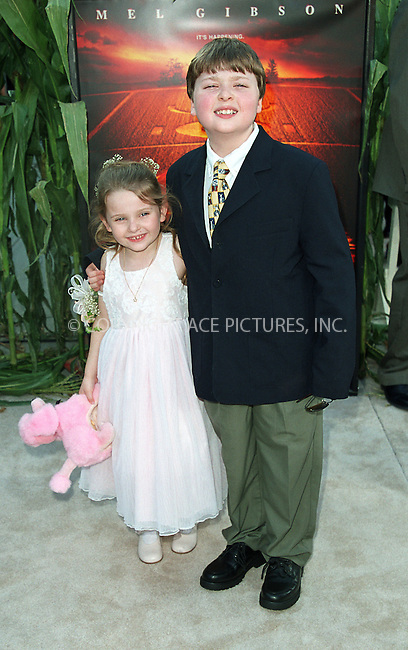 "Abigail Breslin and her brother Spencer Breslin arrive at the world premiere of Touchstone Pictures' movie, ""Signs"" at Lincoln Center, New York. July 29, 2002. Please byline: Alecsey Boldeskul/NY Photo Press.   ..*PAY-PER-USE*      ....NY Photo Press:  ..phone (646) 267-6913;   ..e-mail: info@nyphotopress.com"