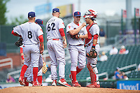Reading Fightin Phils manager Dusty Wathan (62) pulls relief pitcher Reinier Roibal (50) as Carlos Alonso (8) and catcher Jorge Alfaro (11) look on during a game against the New Hampshire Fisher Cats on May 30, 2016 at Northeast Delta Dental Stadium in Manchester, New Hampshire.  New Hampshire defeated Reading 9-1.  (Mike Janes/Four Seam Images)