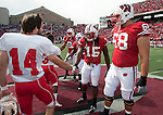 Wisconsin Badgers captains Gabe Carimi (68), Culmer St.Jean (15) Jay Valai (2) and Lance Kendricks (84) shake hands at midfield with the Austin Peay Governors prior to an NCAA football game on September 25, 2010 at Camp Randall Stadium in Madison, Wisconsin. The Badgers beat the Governors 70-3. (Photo by David Stluka)