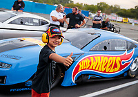 Aug 30, 2019; Clermont, IN, USA; A young fan poses in front of the Hot Wheels sponsored car of NHRA pro mod driver Alex Laughlin during qualifying for the US Nationals at Lucas Oil Raceway. Mandatory Credit: Mark J. Rebilas-USA TODAY Sports
