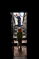 A young girl peers into the dark root cellar for the Knox-Metzker log cabin on the grounds of McVay Elementary School in Westerville at the annual Ned Mosher Apple Butter Festival. The festival held at the cabin every year helps raise money to maintain the cabin as a teaching tool for students at the school.