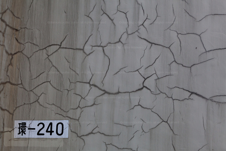 Cracks in the concrete of an overpass support in Tokyo, Japan. Sunday August 24th 2014