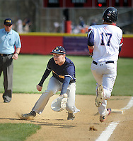 SGHOST22P<br /> Devon Prep first baseman Jimmy Loftus loses the baseball allowing Holy Ghost's John McCrane #17 to reach first base in the first inning Thursday April 21, 2016 at Holy Ghost Prep in Bensalem, Pennsylvania. (William Thomas Cain/For The Inquirer)