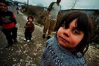 PLEMENTINA / KOSOVO - FEB.2008.BARACCOPOLI ALLE PORTE DI PRISTINA DOVE VIVONO CENTINAIA DI FAMIGLIE ROM. LE LORO CONDIZIONI DI VITA SONO DURE, L'IGIENE E' SCARSA E L'ARIA INQUINATA DALLA VECCHIA CENTRALE ELETTRICA A CARBONE DI OBILIC..FOTO LIVIO SENIGALLIESI..PLEMENTINA / KOSOVO - FEB.2008.Plemetina Camp was established in July of 1999, to replace the refugee areas around the Serbian school in Kosovo Polje. Thousands of Ashkalija, and some Roma, congregated at the school in June of 1999. The site was overwhelmed by those fleeing the Kosovo Polje Mahalas; there was not enough security, accommodation or food. Plemetina was established 1-2 KM from Obili? town, in the shadow of the KEK cooling tower..PHOTO LIVIO SENIGALLIESI