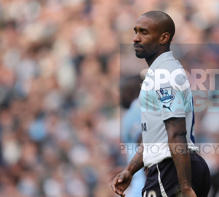 Spurs Jermain Defoe looks on dejected..Manchester City v Tottenham Hotspur in the the Barclays Premier League, at the Etihad Stadium, Manchester. 22nd January 2012.--------------------.Sportimage +44 7980659747.picturedesk@sportimage.co.uk.http://www.sportimage.co.uk/.Editorial use only. Maximum 45 images during a match. No video emulation or promotion as 'live'. No use in games, competitions, merchandise, betting or single club/player services. No use with unofficial audio, video, data, fixtures or club/league logos.