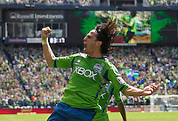 Seattle Sounders FC midfielder Mauro Rosales celebrates a goal during play against the Colorado Rapids at CenturyLink Field in Seattle Saturday July 16, 2011. The Sounders won the game 4-3.