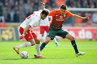 FUSSBALL   1. BUNDESLIGA   SAISON 2011/2012   29. SPIELTAG 1. FC Koeln - SV Werder Bremen                           07.04.2012 Mikael Ishak (li, 1. FC Koeln) gegen Aleksandar Ignjovski (re, SV Werder Bremen)