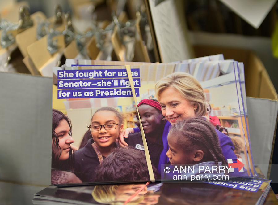 Garden City, New York, USA. April 17, 2016. Campaign literature, including postcards with photo of Hillary Clinton, Democratic presidential primary candidate, with diverse girls, is ready to be picked up by volunteers at the Canvass Kickoff at the Nassau County Democratic Office, part of the GOTV Get Out The Vote for Hillary four day weekend event.