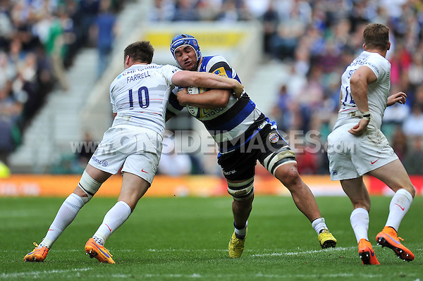 Leroy Houston of Bath Rugby is tackled by Owen Farrell of Saracens. Aviva Premiership Final, between Bath Rugby and Saracens on May 30, 2015 at Twickenham Stadium in London, England. Photo by: Patrick Khachfe / Onside Images
