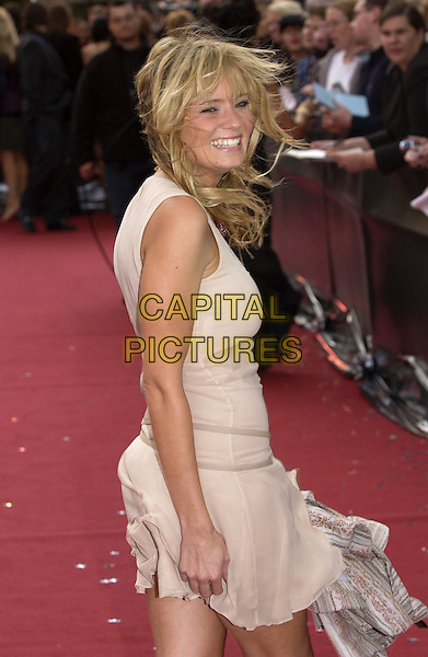 "DANIELLE BRENT.ITV's ""The Celebrity Awards"".London 26 September 2004.half length, windy, cream dress, skirt, blowing.www.capitalpictures.com.sales@capitalpictures.com.©Capital Pictures"