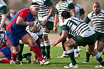 Suli Tuafalele is confronted by Aleni Luteru as he takes the ball forward from a ruck. Counties Manukau Premier Club Rugby game between Ardmore Marist and Manurewa, played at Bruce Pulman Park, Papakura on Saturday July 18th 2009..Ardmore Marist won the game 32 - 5 after leading 10 - 5 at halftime.