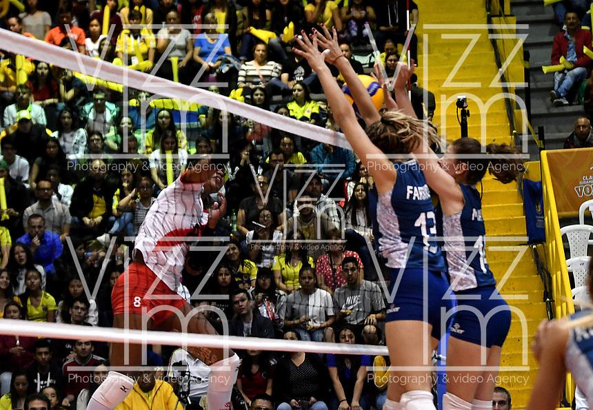 BOGOTÁ-COLOMBIA, 07-01-2020: Blanca Farriol y Victoria Mayer de Argentina, intenta un bloqueo al ataque de balón, a Magullaura Frias de Perú, durante partido entre Argentina y Perú, en el Preolímpico Suramericano de Voleibol, clasificatorio a los Juegos Olímpicos Tokio 2020, jugado en el Coliseo del Salitre en la ciudad de Bogotá del 7 al 9 de enero de 2020. / Blanca Farriol y Victoria Mayer from Argentina, tries to block the attack the ball, to Magullaura Frias from Peru, during a match between Argentina and Peru, in the South American Volleyball Pre-Olympic Championship, qualifier for the Tokyo 2020 Olympic Games, played in the Colosseum El Salitre in Bogota city, from January 7 to 9, 2020. Photo: VizzorImage / Luis Ramírez / Staff.