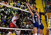 BOGOTÁ-COLOMBIA, 07-01-2020: Blanca Farriol y Victoria Mayer de Argentina, intenta un bloqueo al ataque de balón, a Magullaura Frias de Perú, durante partido entre Argentina y Perú, en el Preolímpico Suramericano de Voleibol, clasificatorio a los Juegos Olímpicos Tokio 2020, jugado en el Coliseo del Salitre en la ciudad de Bogotá del 7 al 9 de enero de 2020. / Blanca Farriol y Victoria Mayer from Argentina, tries to block the attack the ball, to Magullaura Frias from Peru, during a match between Argentina and Peru, in the South American Volleyball Pre-Olympic Championship, qualifier for the Tokyo 2020 Olympic Games, played in the Colosseum El Salitre in Bogota city, from January 7 to 9, 2020. Photo: VizzorImage / Luis Ramírez / Staff.